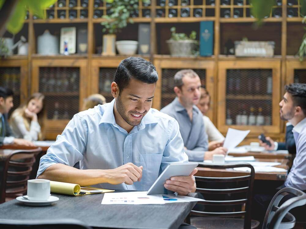 Young man in restaurant studying